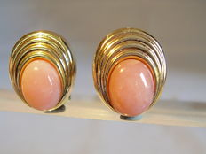 Gold designer earrings with big pink opal cabochons