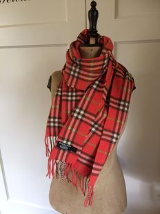 A tomato-red, original Burberry scarf/muffler.