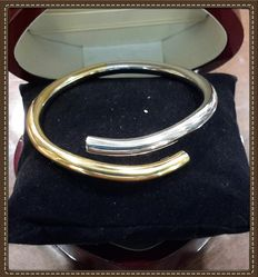 Rigid bracelet in bi-colour 18 kt gold – Weight: 19.5 g - interior diameter: 6 cm