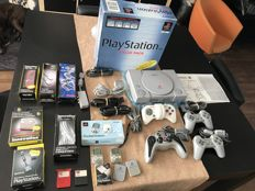 Playstation with 4 controllers, 5 memorycards, 2 PlayStation pockets and all the cables you need!