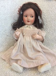 Large Sonneberg girl doll with brown eyes flirt