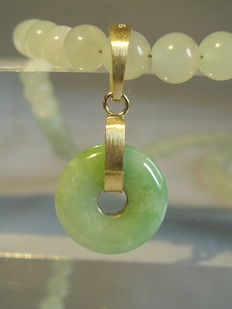 Celadon green jade necklace with golden pendant made of green jade /