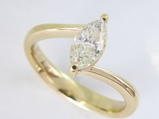 Yellow gold ring set with a 0.65 ct marquise cut diamond