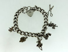 Sterling Silver Bracelet With Various Ornaments - 18 cm