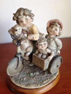 "Capodimonte, Giuseppe Armani ""Children on cycle with sidecar"""