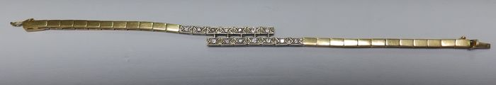 18 kt yellow and white gold Two-tone Bracelet with 14 Diamonds of 0.55 ct. Length: 18.5 cm