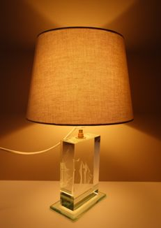 Glass table lamp with hologram of ship in the base