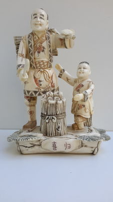 Sculpture of father and son made from bone - China - signed - around 1950