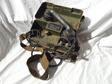 Field telephone with metal case and shoulder strap.