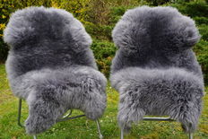 Lot with 2 genuine and high-quality grey lambskins/sheepskins
