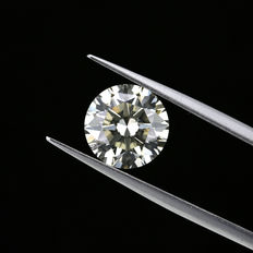Natural Fancy Light Brown Greenish Yellow 3.04 ct. Round brilliant cut diamond. GIA Certified