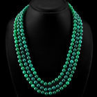 Necklace made of three strands of emeralds on an adjustable cord.