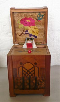 Art Deco wooden radio cabinet as cigarettes machine with melody