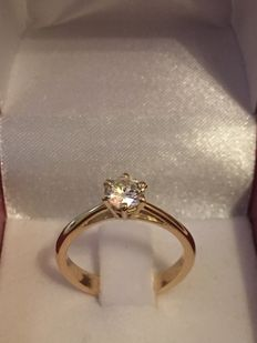 Solitaire ring in 18 kt gold and with a diamond = size 52