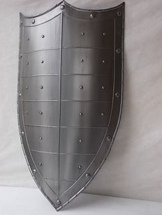 Polished steel medieval shield replica with three-pointed top and studs