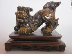 Tiger's eye with wooden base – China – Second half of the 20th century