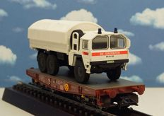 Märklin H0 - 48670 - 4-axle heavy duty carriage of the DB AG, loaded with MAN truck