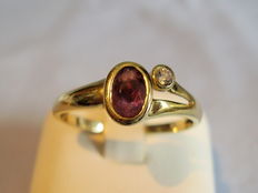 Gold ring with rare pink tourmaline and zircon
