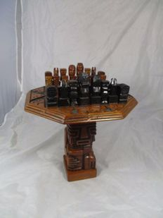 Hardwood chess table from South America with hardwood chess pieces depicting the Incas, Mayans and Aztecs