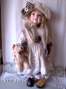 Collectible porcelain doll with a bow - RF - Germany
