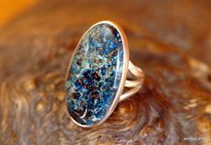 A silver ring with a big boulder opal