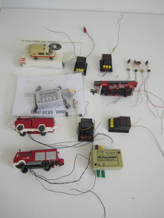 Scenery H0 – Various cars with flashing lights and transition lights, controlled