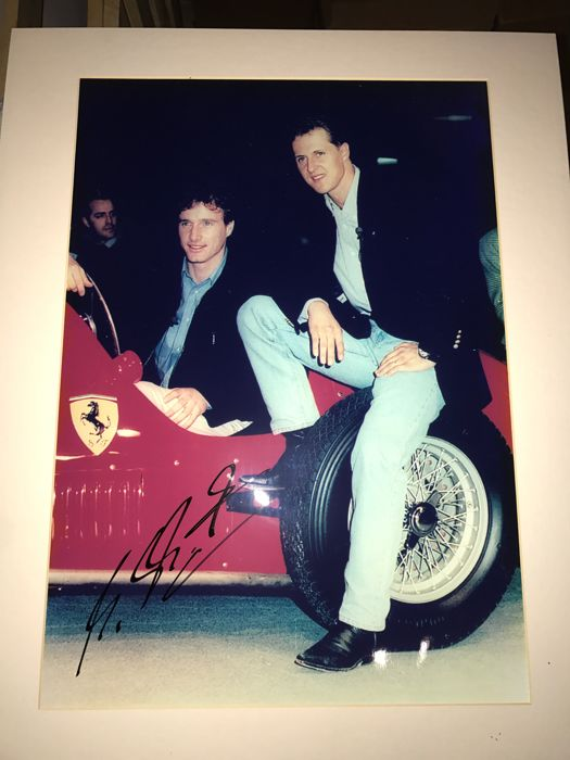 Original color photo autographed by Michael Schumacher with Ferrari