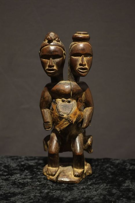 Male seated Nkisi Mirror Fetish Figure with 2 Heads seated on a dog - BAKONGO - D.R. Congo