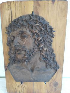 Beautiful plaster and marble icon of Christ on fir wood