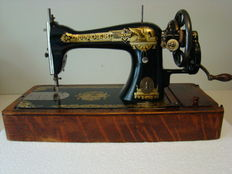 Singer 15K sewing machine with wood dust cover, Scotland, 1913