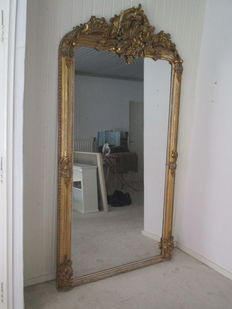 A large Napoleon III gilt gesso and wooden chimney mirror - France - late 19th century