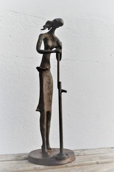 Artist unknown - patinated bronze image of a Jazz singer with microphone.