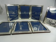 Three silver frames. Two connected sets of three sterling frames for six photos and a single one.
