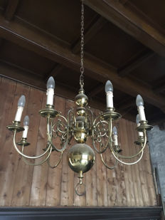 Set of beautiful brass chandeliers with eight lights