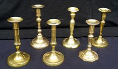 Six antique metal brass candlesticks - first half of the twentieth century - Italy