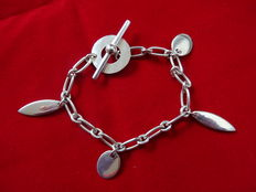 Silver bracelet, silver 925, 18.5 cm long, with charms.