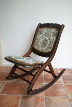 Small wooden folding rocking chair, hand-made, upholstered in tapestry fabric.