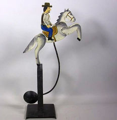 Antique cast iron pendulum, riding cowboy, approx. 47 cm