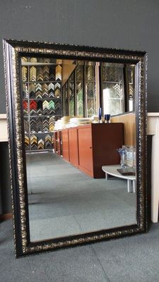 Large mirror with facet - black gold - wide ornamental frame.