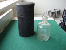 Pharmacy - Glass measuring bottle in original container.