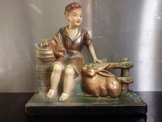 Art deco plaster patinated image of a child with his rabbits -Design M.Toscana