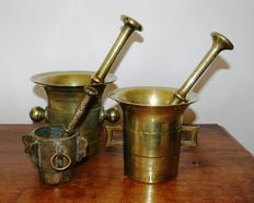 Three bronze mortars