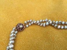 Freshwater cultivated light green pearl necklace with pearl and rubies clasp, length - 57cm