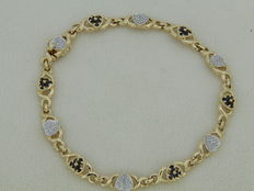 Bracelet in 18 kt gold with 18 sapphires and 6 diamonds - length 19 cm