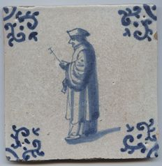 "Tile with a depiction of a ""clergyman"", possibly with a ""Tau staff and an incense burner"" - Mid17th century"