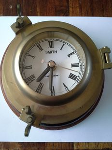 Beautiful solid brass old Smith London porthole clock.