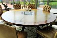 Large round mahogany table in Regency style with 8 leather chairs, England, London, last quarter of the 20th century