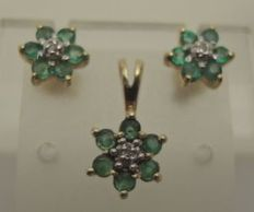 Set of 14 kt gold earrings + a pendant with emerald and diamond