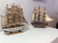 Handmade wooden model sailing ships with an average size of 30 cm x 30 cm