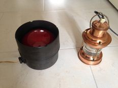 Two lamps one brass Ships Lamp and one Decorative Theatre light of Bakelite with a red lens - 20th century.